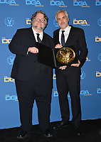 LOS ANGELES, CA. February 03, 2019: Guillermo del Toro & Alfonso Cuaron at the 71st Annual Directors Guild of America Awards at the Ray Dolby Ballroom.<br /> Picture: Paul Smith/Featureflash