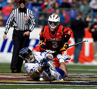 CJ Costabile (9) of Duke tries to control the ball on a face-off with  Jake Bernhardt (13) of Maryland during the Face-Off Classic in at M&T Stadium in Baltimore, MD