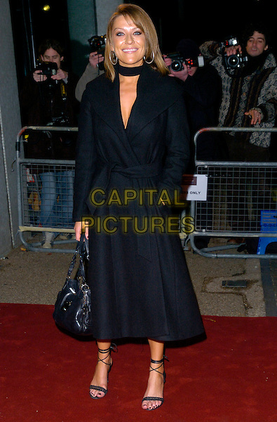 "ZOE LUCKER.Arrives at ""An Audience With Take That"".at The London Television Studios,.London, England, December 2nd 2006..full length black coat.CAP/CAN.©Can Nguyen/Capital Pictures"
