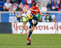 HARRISON, NJ - MARCH 08: Emily Sonnett #14 of the United States and Marta Cardona #9 of Spain fight for the ball during a game between Spain and USWNT at Red Bull Arena on March 08, 2020 in Harrison, New Jersey.