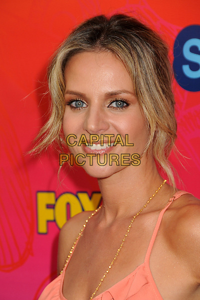 JESSALYN GILSIG.FOX 2010 Summer TCA All-Star Party held at Pacific Park on the Santa Monica Pier, Santa Monica, California, USA..August 2nd, 2010.headshot portrait orange pink peach gold necklace .CAP/ADM/BP.©Byron Purvis/AdMedia/Capital Pictures.