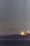 The Titan 34D rocket carrying a KH-9 Hexagon reconnaissance satellite lift off seconds before the explosion at Vanderberg Air Force Base, CA.