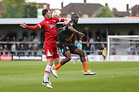 Calum Dyson of Grimsby Town and Simeon Akinola of Barnet during the Sky Bet League 2 match between Barnet and Grimsby Town at The Hive, London, England on 29 April 2017. Photo by David Horn.