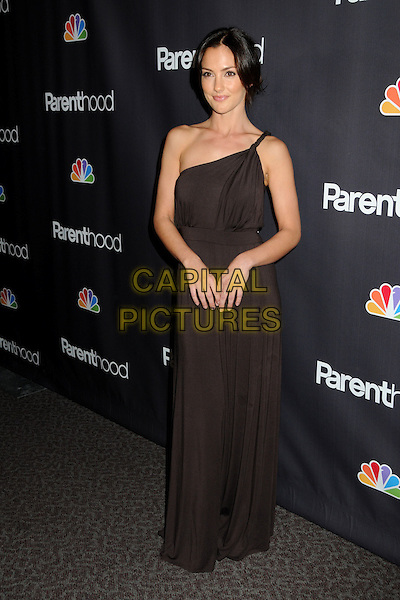"MINKA KELLY .""Parenthood"" Premiere Screening held at the Director's Guild of America, West Hollywood, California, USA ,.22nd February 2010..arrivals full length one shoulder brown dress long maxi twisted strap .CAP/ADM/BP.©Byron Purvis/Admedia/Capital Pictures"