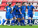 Stranraer's Steven Bell (6) is congratulated after he scores their first goal.