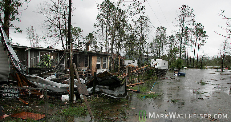 Homes damaged by Hurricane Dennis and flooded by the Blackwater River in the rual community of East Milton, Florida July 10, 2005.  Milton is fifteen miles north of Navarre Beach and is one of the heavier hit areas of the Florida panhandle.