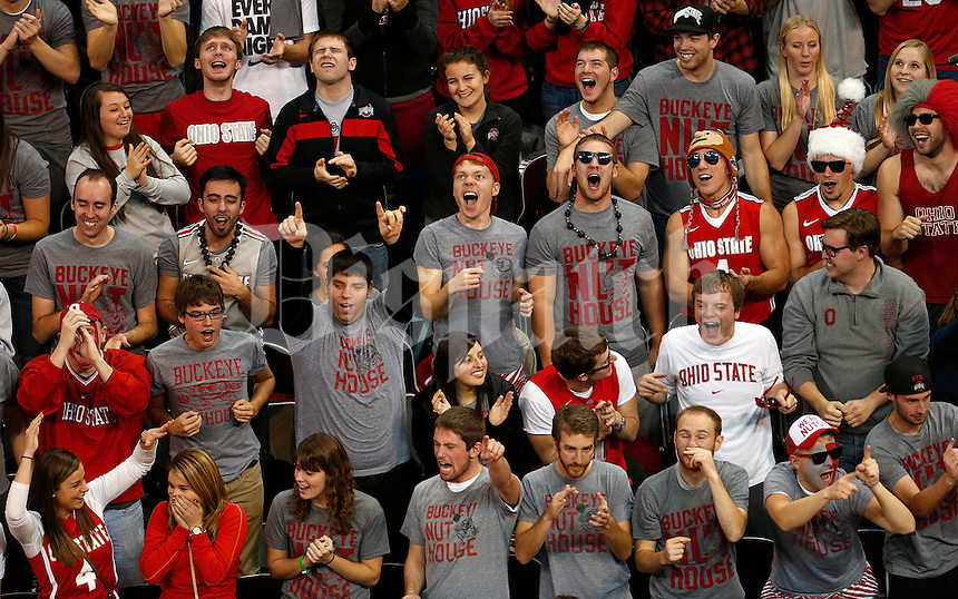 Ohio State Buckeyes fans react in the first half of the college basketball game between the Ohio State Buckeyes and the Ohio Bobcats at Value City Arena in Columbus, Tuesday evening, November 12, 2013. The Ohio State Buckeyes defeated the Ohio Bobcats 79 - 69. This was the first meeting of the teams in 19 years and the first ever game between them at Value City Arena. (The Columbus Dispatch / Eamon Queeney)