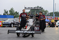 Sept. 16, 2012; Concord, NC, USA: Crew members push the car of NHRA top fuel dragster driver Shawn Langdon during the O'Reilly Auto Parts Nationals at zMax Dragway. Mandatory Credit: Mark J. Rebilas-