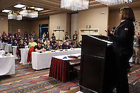 Karen Hagedorn, representing sponsor ExxonMobil wishes the mushers well during the mandatory musher meeting at the Millenium hotel two days prior to the start of Iditarod 2013.   Thursday February 28, 2013..Photo (C) Jeff Schultz/IditarodPhotos.com  Do not reproduce without permission.