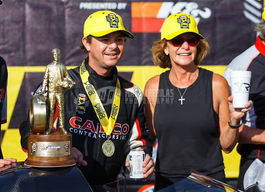 Jul 9, 2017; Joliet, IL, USA; NHRA top fuel driver Steve Torrence celebrates with mother Kay Torrence after winning the Route 66 Nationals at Route 66 Raceway. Mandatory Credit: Mark J. Rebilas-USA TODAY Sports