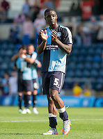Goal scorer Anthony Stewart of Wycombe Wanderers applauds the supporters after the 3-0 victory during the Sky Bet League 2 match between Wycombe Wanderers and York City at Adams Park, High Wycombe, England on 8 August 2015. Photo by Andy Rowland.