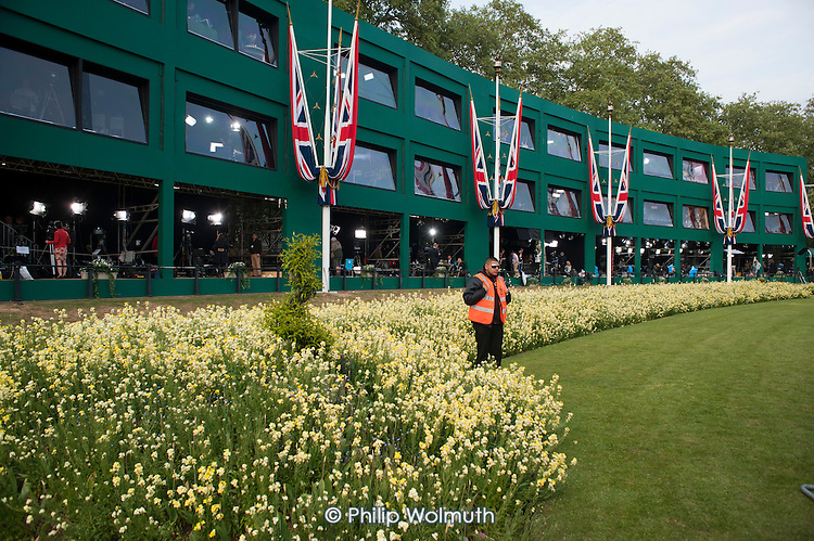 A security guard in front of a temporary media centre constructed opposite Buckingham Palace for the Royal Wedding.