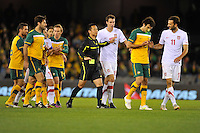 MELBOURNE, AUSTRALIA - JUNE 7: Mile Jedinak of the Socceroos is shown a yellow card during an international friendly match between the Qantas Australian Socceroos and Serbia at Etihad Stadium on June 7, 2011 in Melbourne, Australia. Photo by Sydney Low / AsteriskImages.com