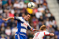 Blas Perez (7) of FC Dallas goes up for a header with Dax McCarty (11) of the New York Red Bulls. The New York Red Bulls defeated FC Dallas 1-0 during a Major League Soccer (MLS) match at Red Bull Arena in Harrison, NJ, on September 22, 2013.