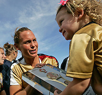 USA's Christie Rampone celebrates with the trophy and her daughter Rylie Cate after the finals. The United States defeated Denmark 2-1 during the finals of the Algarve Cup 2008 at Municipal Stadium in Vila Real de San Antonio, Portugal on March 12, 2008. Paulo Cordeiro/isiphotos.com..