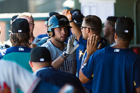 Peoria Javelinas third baseman Hudson Potts (13), of the San Diego Padres organization, is congratulated by his teammates in the dugout after hitting a home run during an Arizona Fall League game against the Surprise Saguaros at Surprise Stadium on October 17, 2018 in Surprise, Arizona. (Zachary Lucy/Four Seam Images)