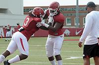 NWA Democrat-Gazette/DAVID GOTTSCHALK University of Arkansas Razorback defensive lineman Armon Watts (right) runs through drills with McTelvin Agim Wednesday, August 8, 2018, during football practice on campus in Fayetteville.