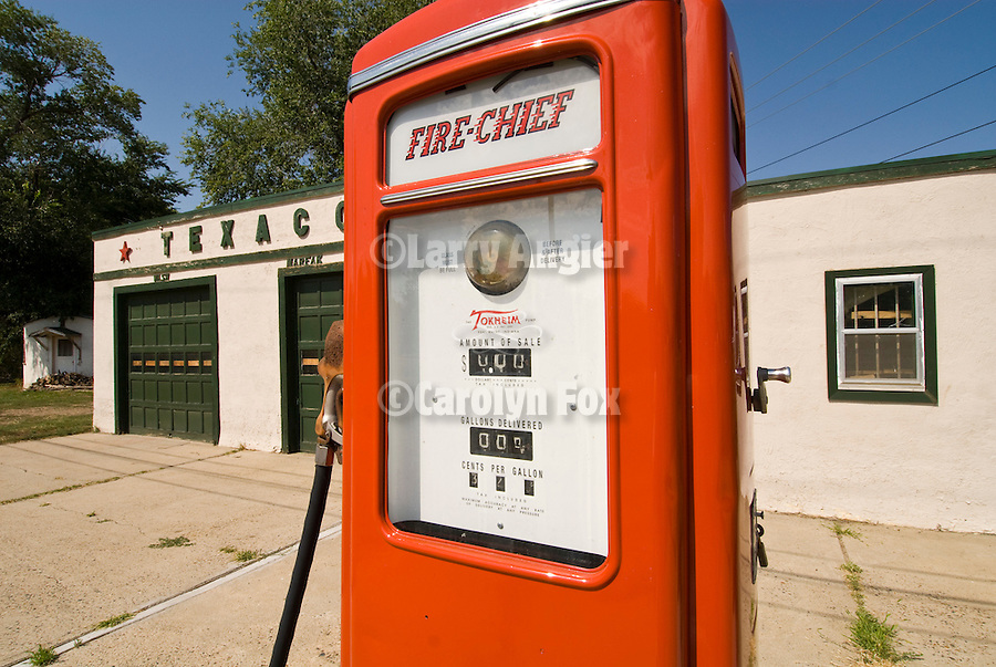 Restored road-side Texaco gas station with rounded walls, red gas pump with 32.9 cents per gallon pricing, Glendive, Montana.