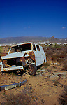 Van dumped and stripped and abandoned on rubbish dump in Canarian countryside. Cabo blanco, Tenerife, 1994