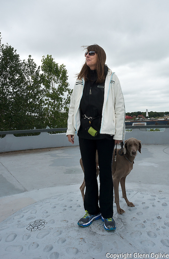Susan DesJardine and her dog Thomas check out the echo at the water treatment plant lookout platform.