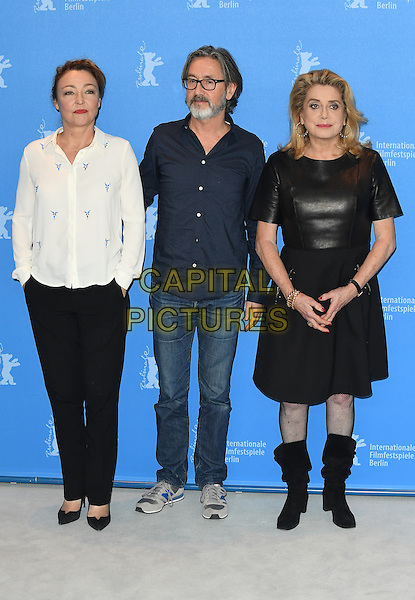 BERLIN, GERMANY - FEBRUARY 14: Catherine Frot, Director Martin Provost and French actress Catherine Deneuve attends a photo call for The Midwife (Sage Femme) during the 67th Berlinale International Film Festival Berlin at the Grand Hyatt Hotel on February 14, 2017 in Berlin, Germany.<br /> CAP/BEL<br /> &copy;BEL/Capital Pictures