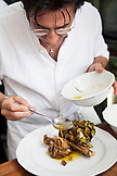 RUSSIA, Moscow. Chef Valentino Bontempi finishing a dish at his restaurant, Bontempi.
