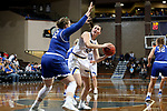 SIOUX FALLS, SD - NOVEMBER 15: South Dakota State Jackrabbits's Kallie Theisen #12 looks around the defense of Jessica Mieras #52 from Dakota Wesleyan during their game Friday evening at the Sanford Pentagon in Sioux Falls, SD. (Photo by Dave Eggen/Inertia)