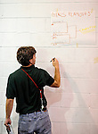 8 November 2009: VCS coach Peter Goff notes the brackets in the 2009 High School Volleyball State Championships hosted by Vermont Commons School at the Sports and Fitness Edge in South Burlington, Vermont. The Enosburg Falls Hornets successfully defended their boys' title while the VCS Flying Turtles rallied to maintain their girls' team crown. Mandatory Credit: Ed Wolfstein Photo