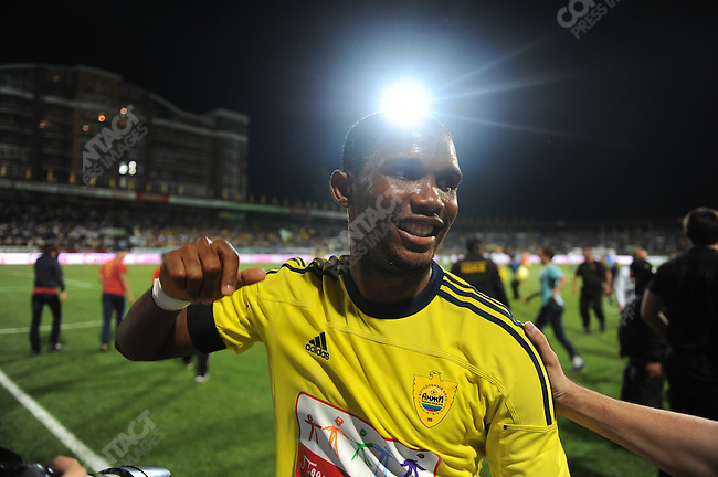 Samuel Eto'o leaves the field after a match between Anzhi and Volga in the Russian league, his first home game for Anzhi, as fans try to greet him.  Anzhi won 2-1 with Eto'o scoring the first goal for Anzhi Makhachala in Dagestan, Russia. Eto'o, a star forward and native of Cameroon, left the Italian club Inter Milan for Anzhi in a dealing making him one of the highest paid footballers in the world. September 10, 2011.