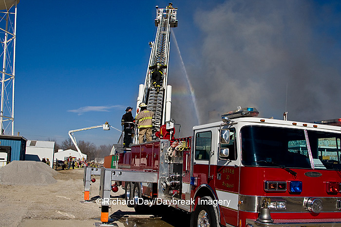 63818-02303 Firefighters extinguishing warehouse fire using aerial ladder truck, Salem, IL