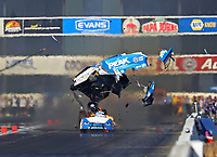 Feb 9, 2018; Pomona, CA, USA; NHRA funny car driver John Force explodes the carbon fiber body off his car during qualifying for the Winternationals at Auto Club Raceway at Pomona. Force would walk away from the incident. Mandatory Credit: Mark J. Rebilas-USA TODAY Sports
