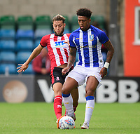 Sheffield Wednesday's Liam Palmer under pressure from Lincoln City's Jorge Grant<br /> <br /> Photographer Chris Vaughan/CameraSport<br /> <br /> Football Pre-Season Friendly - Lincoln City v Sheffield Wednesday - Saturday July 13th 2019 - Sincil Bank - Lincoln<br /> <br /> World Copyright © 2019 CameraSport. All rights reserved. 43 Linden Ave. Countesthorpe. Leicester. England. LE8 5PG - Tel: +44 (0) 116 277 4147 - admin@camerasport.com - www.camerasport.com