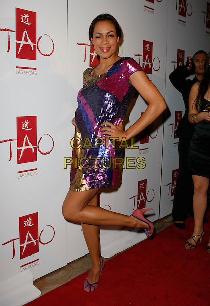 ROSARIO DAWSON.TAO Las Vegas Celebrates its Two Year Anniversary In Sin City, Las Vegas, Nevada, USA..November 10th, 2007.full length purple sequins sequined dress pink red blue hand on hip posing leg up funny eye closed winking .CAP/ADM/MJT.©MJT/AdMedia/Capital Pictures.