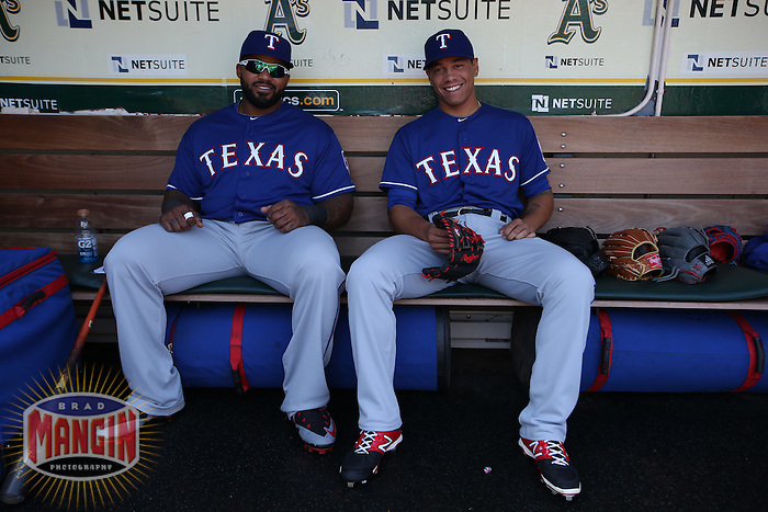 OAKLAND, CA - APRIL 9:  Prince Fielder #84 and Keone Kela #50 of the Texas Rangers sit in the dugout before the game against the Oakland Athletics at O.co Coliseum on Thursday, April 9, 2015 in Oakland, California. Photo by Brad Mangin