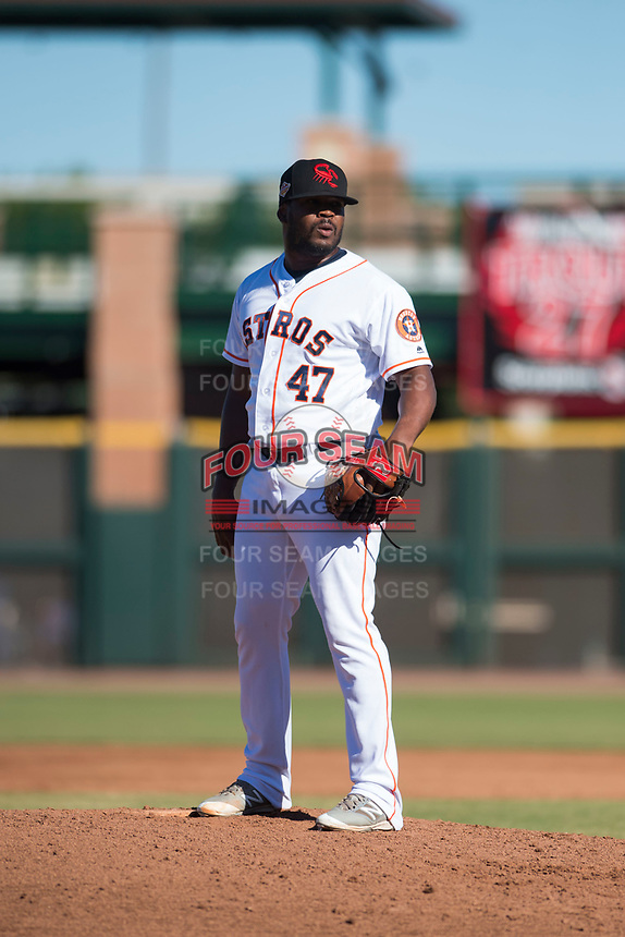 Scottsdale Scorpions relief pitcher Erasmo Pinales (47), of the Houston Astros organization, looks in for the sign during an Arizona Fall League game against the Surprise Saguaros at Scottsdale Stadium on October 26, 2018 in Scottsdale, Arizona. Surprise defeated Scottsdale 3-1. (Zachary Lucy/Four Seam Images)