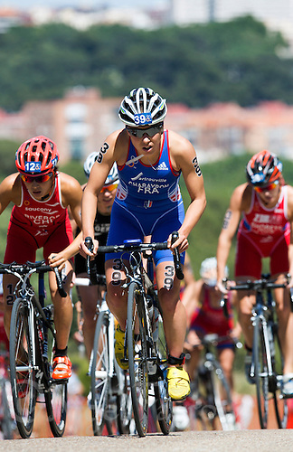 01 JUN 2013 - MADRID, ESP - Emmie Charayron (FRA) (centre, in blue and white) of France leads a pack to the top of the hill on the bike during the elite women's ITU 2013 World Triathlon Series round in Casa de Campo, Madrid, Spain (PHOTO (C) 2013 NIGEL FARROW)