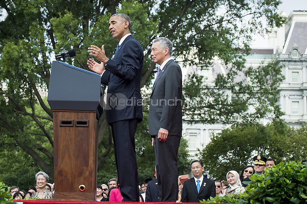 Prime Minister Lee Hsien Loong of Singapore looks on as United States President Barack Obama speaks during official welcoming ceremonies on the South Lawn of the White House in Washington, DC on August 2, 2016. Lee is on a State Visit to the United States.  <br /> Credit: Pete Marovich / Pool via CNP/MediaPunch