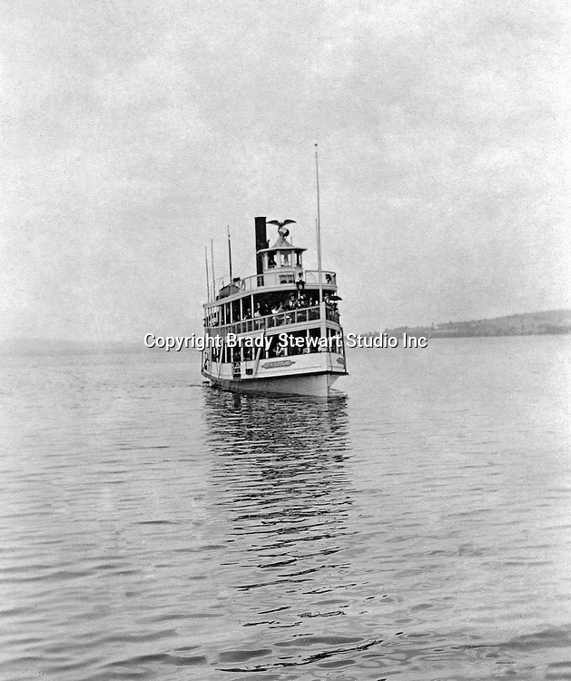 Lakewood NY: The City of Cleveland ferry arriving at the Kent House pier -  1901. Photographs taken during a church field trip to Chautauqua Institution in New York (Lake Chautauqua). The Stewart family and friends visited Chautauqua during 1901 to hear Stewart relative, Dr. S.H. Clark  speak at the institute. Alice Brady Stewart chaperoned and Brady Stewart came along to photograph the trip.  The Gallery provides a glimpse of how the privileged and church faithful spent summers at Lake Chautauqua at the turn of the century.