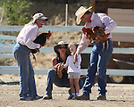Workers explain how a chicken race works to Trinity Kennedy, 3, of Reno, during the 51st Annual Virginia City International Camel Races in Virginia City, Nev. on Sept. 10, 2010..Photo by Cathleen Allison