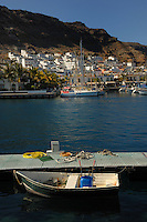 Wheel barrow in rowing boat tied up to pontoon Puerto Mogan, Gran Canaria, Canary Islands, Spain