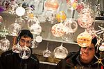 © Joel Goodman - 07973 332324 . 21 November 2013 . Manchester , UK . Men selling glass balls . Candid photos of the Christmas Markets in Manchester City Centre . Photo credit : Joel Goodman