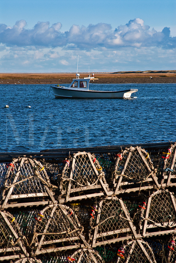 Stacked row of lobster traps, Nauset Harbor, East Orleans, Cape Cod, MA.