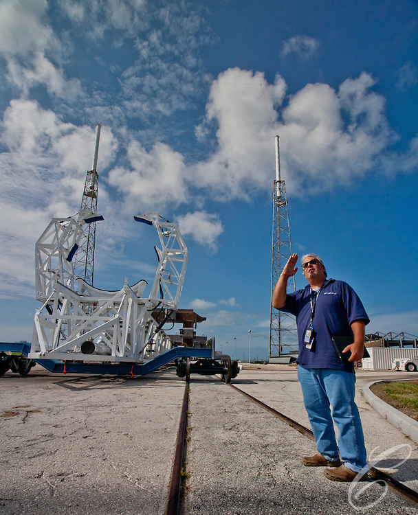 SpaceX's Bobby Block describes how the launch structure raises the Falcon 9 into launch position. The Launch support structure at SpaceX's Launch Complex 40   at  Cape Canaveral, Florida sits on rails. The rails allow the the rocket to be quickly rolled from the hangar to the pad before erecting it to the vertical position.