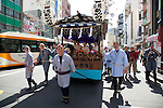 Tokyo, Japan - Men pull a musical float during the Sanja Matsuri in Asakusa district, May 19, 2013. The Sanja Matsuri is one of the Three Great Shinto Festivals in Tokyo and is held on the third weekend of May at Asakusa Temple. (Photo by Rodrigo Reyes Marin/AFLO)..