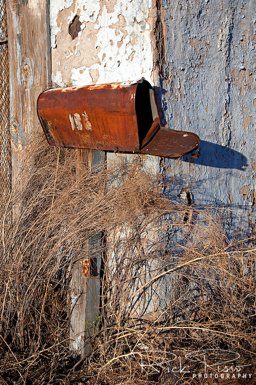 Rusted mailbox and weathered building, Holbrook, Arizona.