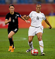Hayley Moorwood, Angela Hucles. The USWNT defeated New Zealand, 4-0, during the 2008 Beijing Olympics in Shenyang, China.  With the win, the USWNT won group G and advanced to the semifinals.