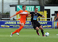 Pictured L-R: Andrea Orlandi of Swansea against Lee Trundle of Neath. Saturday 17 July 2011<br /> Re: Pre season friendly, Neath Football Club v Swansea City FC at the Gnoll ground, Neath, south Wales.