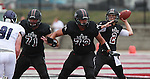 Lindenwood-Belleville QB Trey Phipps (2, right) looks for a receiver as he gets some blocking from linemen Wes Hockaday (71, left) and Alex Vega (73) in the first half during the first football game in Lindenwood-Belleville history.  At far left is Avila DL Jow Sublette (91).