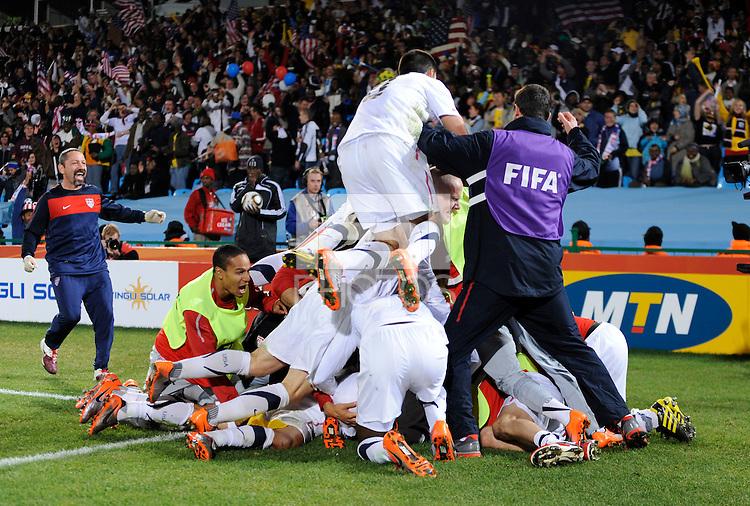 Landon Donovan of USA celebrates the winning goal with team mates