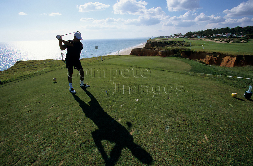 Golfer on a coastal golf course .